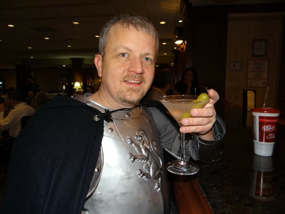 David dressed as a knight with a martini