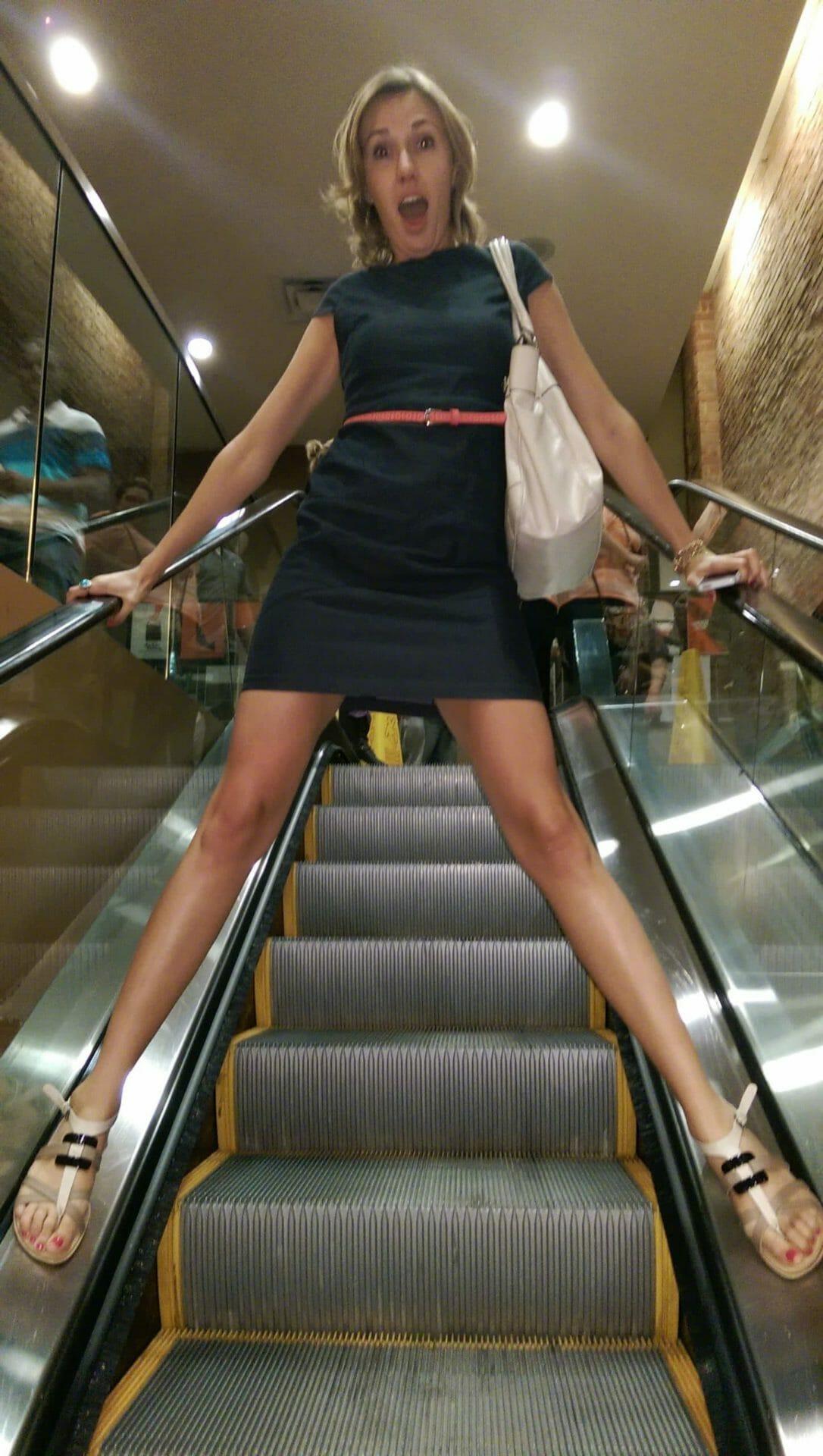 Cristi Rides the Escalator