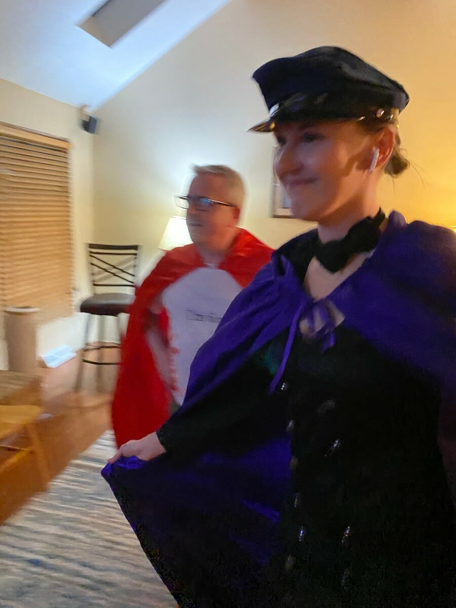 Cristi and David wearing capes